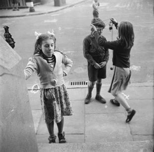 Photograph of children playing outside [1949-54] by Nigel Henderson 1917-1985
